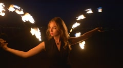 Young blonde woman with flaming torches Stock Footage