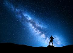 Milky Way and silhouette of a man. Night landscape Stock Photos