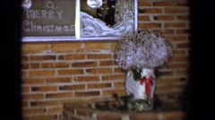 1958: christmas decoration display outside in front of a traditional brick home Stock Footage