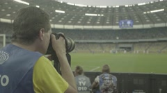 Photo.The photographer takes pictures during the match at the stadium. Stock Footage
