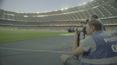 Photo.Photographer working in the stadium during the match. Media. Press. Stock Footage