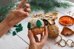 Creative diy hobby. Handmade craft christmas decoration, balls and garland Stock Photos
