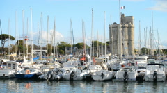 Boats parked in the harbor in the historic part of La Rochelle, France. Stock Footage