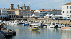 Boats and yachts in the harbour of the village st Martin, France. Stock Footage