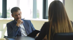 The employer asks questions to the woman in the interview Stock Footage