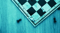 Empty chess board on table with chesspieces falling Stock Footage