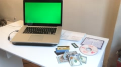 Green Screened Laptop Crime Scene With Money, Credit Cards Stock Footage