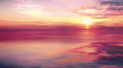 Sunset scene with sea calm and sun fall behind the clouds in background Stock Footage