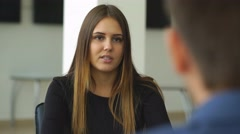 A woman answers questions of the employer at the interview Stock Footage