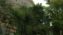 Tilting Shot Showing Lush Vegetation Adjacent to the Medieval Windsor Castle Stock Footage