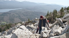 Couple Trying to Find Trail in Mountains Stock Footage