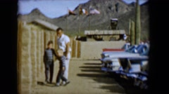 1958: man with children in parking lot in front of mountain TUCSON, ARIZONA Stock Footage