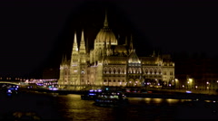 Night time lapse of the Parliament and cruises in the Danube Stock Footage
