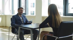 Smiling the employer asks questions to the woman in the interview Stock Footage