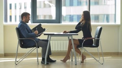 The employer asks ridiculous questions to a woman at the interview Stock Footage