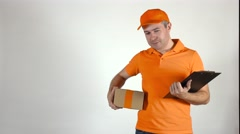 Delivery man in orange uniform giving a small parcel. Light gray backround, 4K Stock Footage