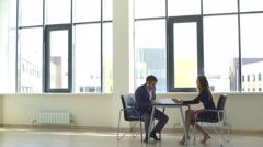 A successful businessman discusses graphics businesswoman Arkistovideo