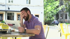 Happy man reading newspaper during lunch, slider shot Stock Footage