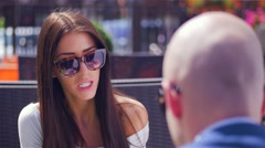 Young girl is sitting with a man. They are arguing. Stock Footage
