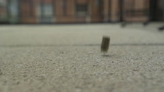9mm Bullet Slow Motion Bouncing Exterior Shot Stock Footage