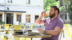 Man drinks beer and resting during lunch Stock Footage