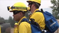 Firefighters head out to battle forest fire. Stock Footage