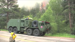 Montage of firefighting by the Forest Service and National Guard. Stock Footage