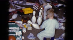 1959: happy brothers playing with toys in living room of house DISNEYLAND, Stock Footage