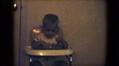 1959: the boy having food very stylish on their kid chair DISNEYLAND, CALIFORNIA Stock Footage