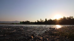 Mountain river flowing down into the valley. Sun Stock Footage