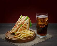 Fast food meals at sandwich bar, fries and cola drink Stock Photos