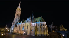 Night time lapse of visitors in the Roman Catholic Matthias Church in Stock Footage