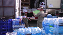 National Guard army troops distribute food and relief aid to people after a Stock Footage