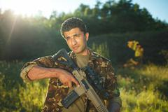 Man of Arab nationality in camouflage with a shotgun Stock Photos