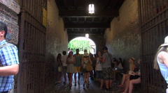 Tourists near Juliet's statue on in Verona Stock Footage
