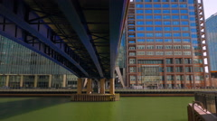 Panning Shot Under DLR Bridge in the Docklands District (Canary Wharf) of London Stock Footage