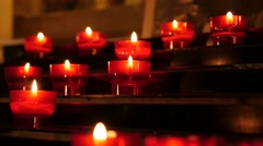 Slow motion Christian prayer votive candles in candle rack 1920X1080 HD foota Stock Footage