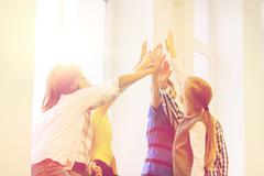 Group of school kids making high five gesture Stock Photos