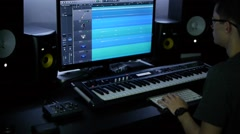 Man mixing in home studio Stock Footage