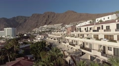 Los Gigantes buildings and beach, Tenerife aerial view Stock Footage
