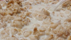 Tilting milk and corn flakes mixed for natural breakfast  4K 2160p 30fps Ultr Stock Footage