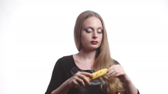 Beautiful young woman with red lips eating banana Stock Footage