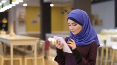 Young Muslim Girl Using Tablet And Smiling At The Camera Stock Footage