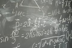 Math formulas on black board Stock Photos