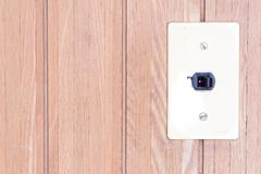 Japanese retro electrical switch on the wooden wall Stock Photos