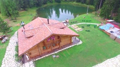 Chalet along Mountain Lake Stock Footage