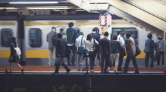 People waiting to board trains at the subway station in Tokyo Stock Footage