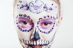 Girl with Halloween face art on white background Stock Photos