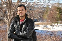 Indian Young Man wioth Arms Crossed Stock Photos