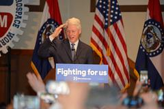 Former President Bill Clinton Salutes to Hillary Supporters Stock Photos